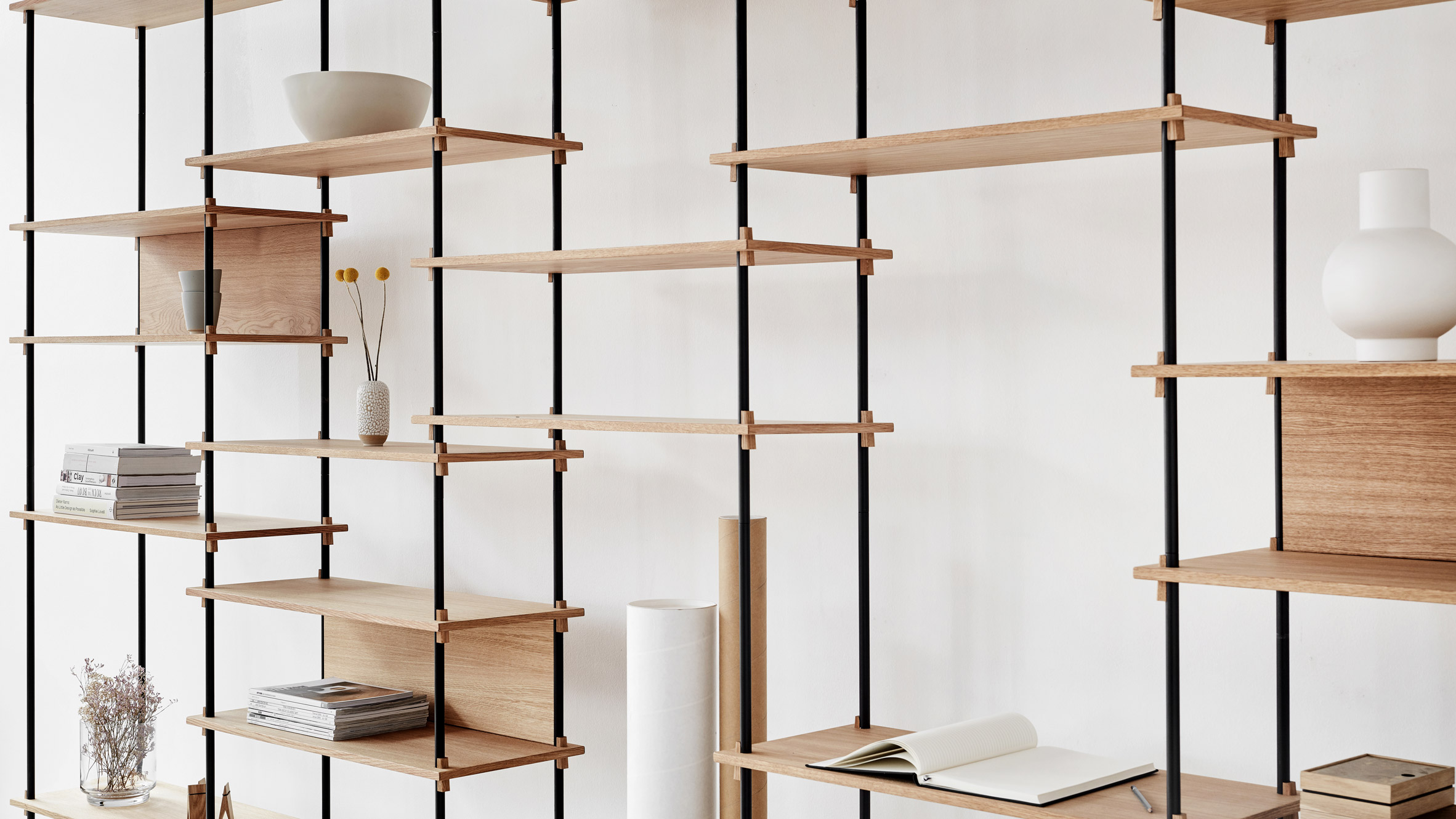 Moebe creates flexible shelving system that is held together by wooden wedges