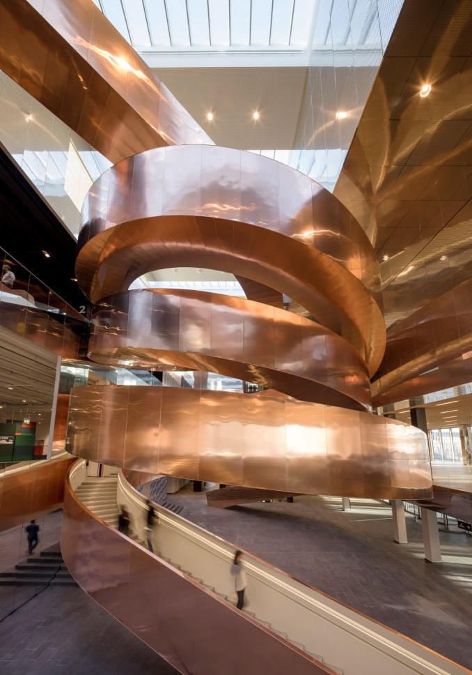 Velux skylights illuminate copper double spiral staircase in CEBRA's