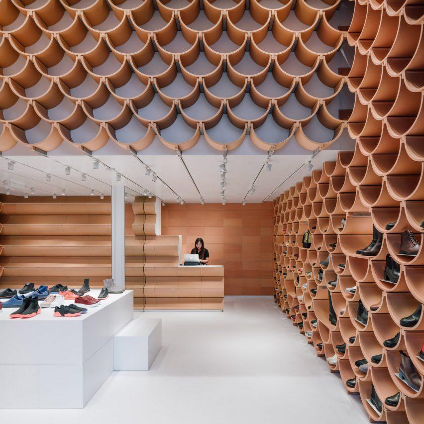 81c5d878296a Terracotta tiles create shelves in Kengo Kuma-designed Camper store ...