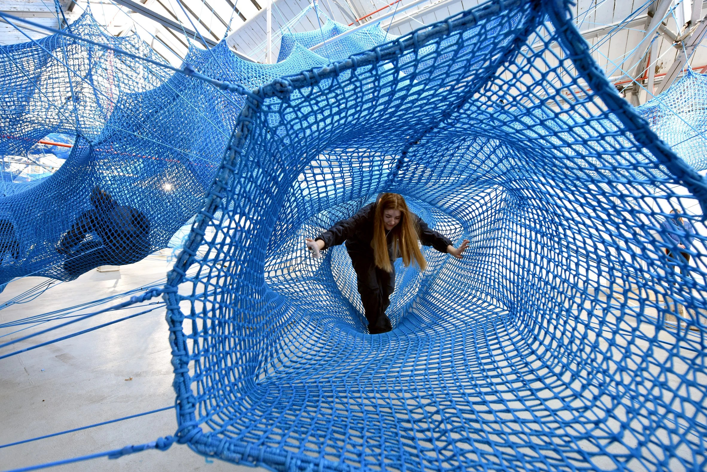 Anya Hindmarch and Numen/For Use create woven network of blue tunnels at London Fashion Week