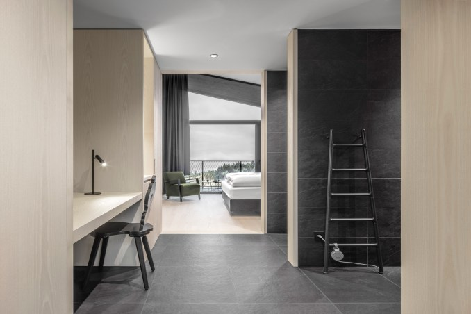 A hotel room inside Hotel Milla Montis by Peter Pichler Architecture