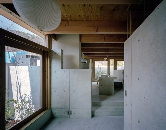 Concrete interiors of a Japanese house by Fujiwaramuro Architects
