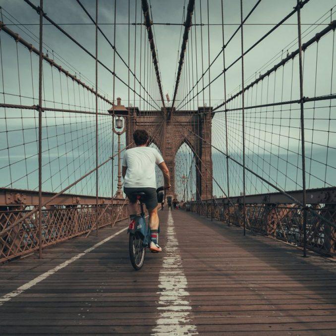 Cycling over New York's Brooklyn Bridge