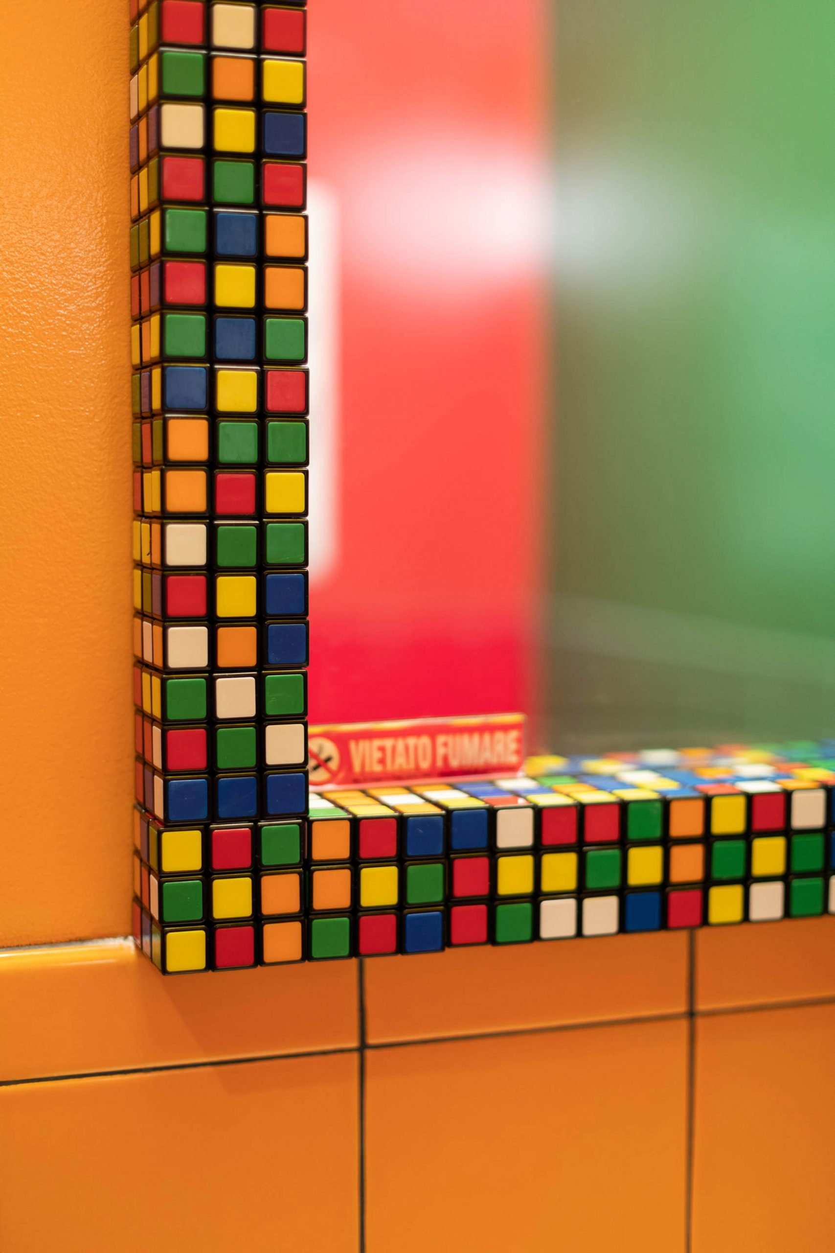 Rubik's Cube mirrors in the bathrooms of Caffettiera Caffé Bar