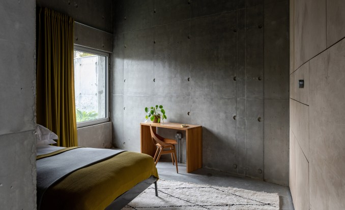 A bedroom inside Concrete House by RAW Architecture Workshop in East Sussex