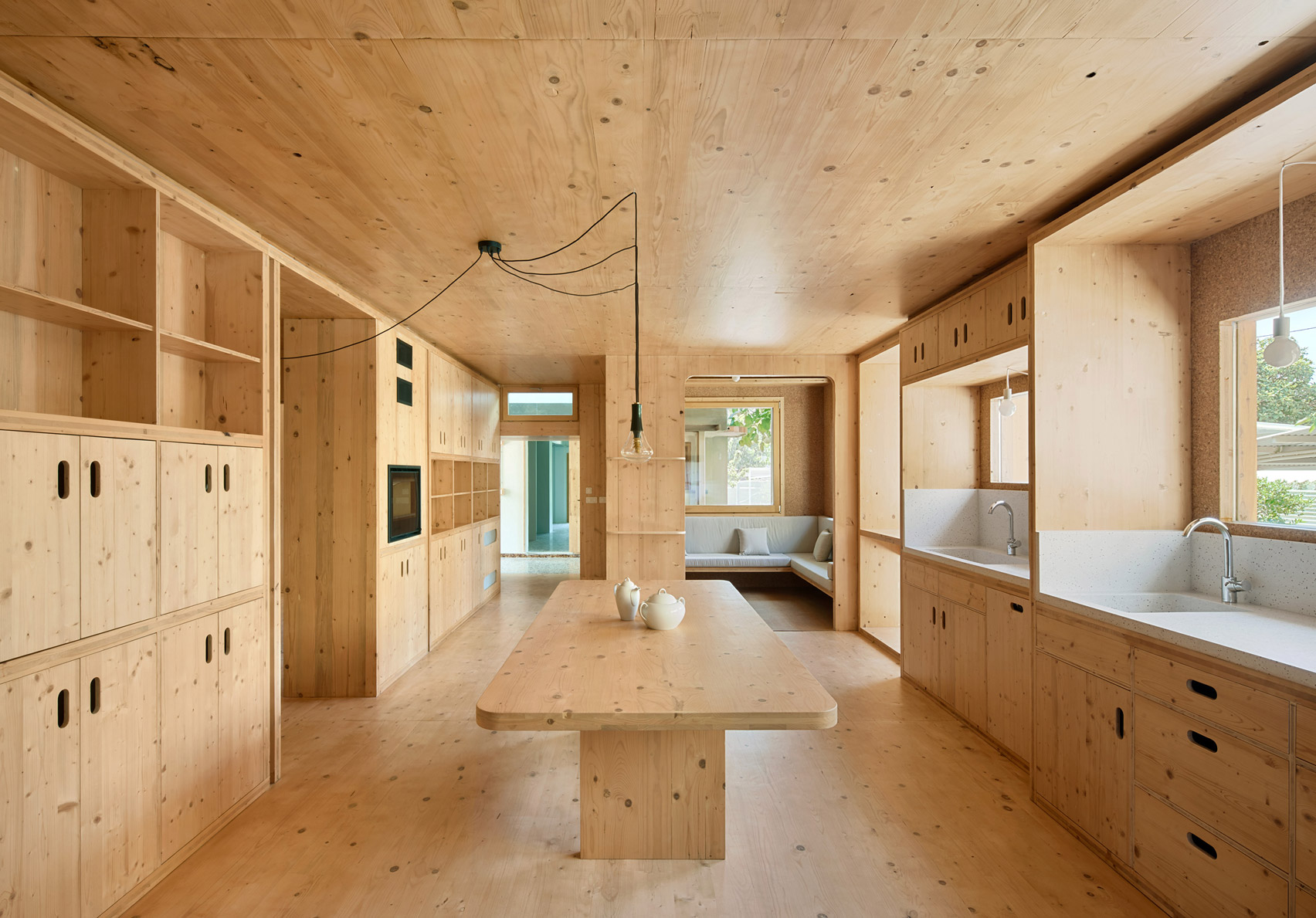cross laminated timber is used in the multi use kitchen diner space, MAS JEC by Aixopluc