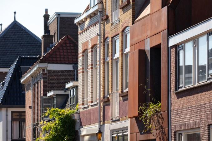 Red exteriors of Utrecht house by Zecc Architecten