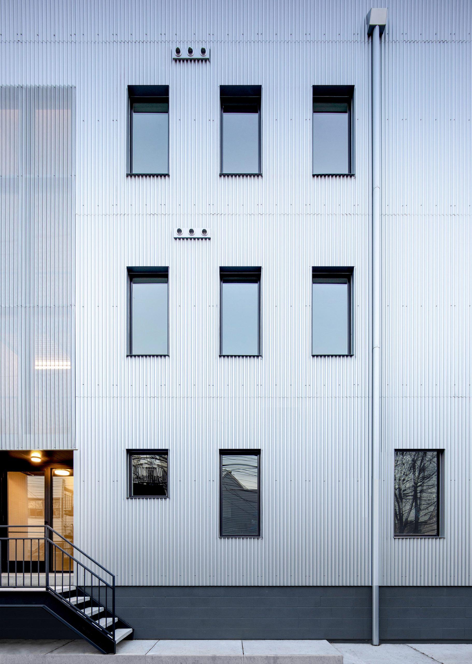 Corrugated metal cladding