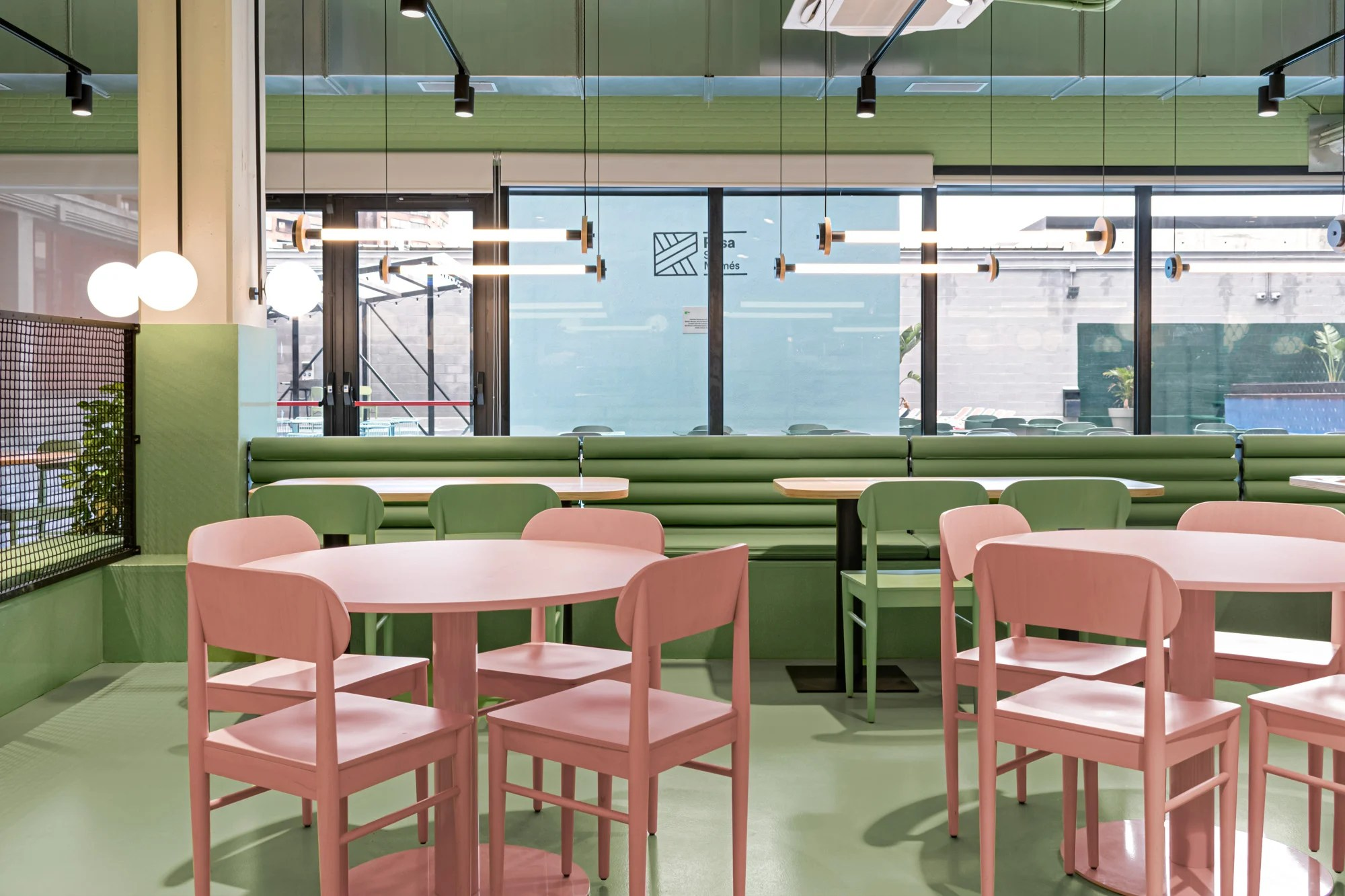 The dining area has green walls and floors