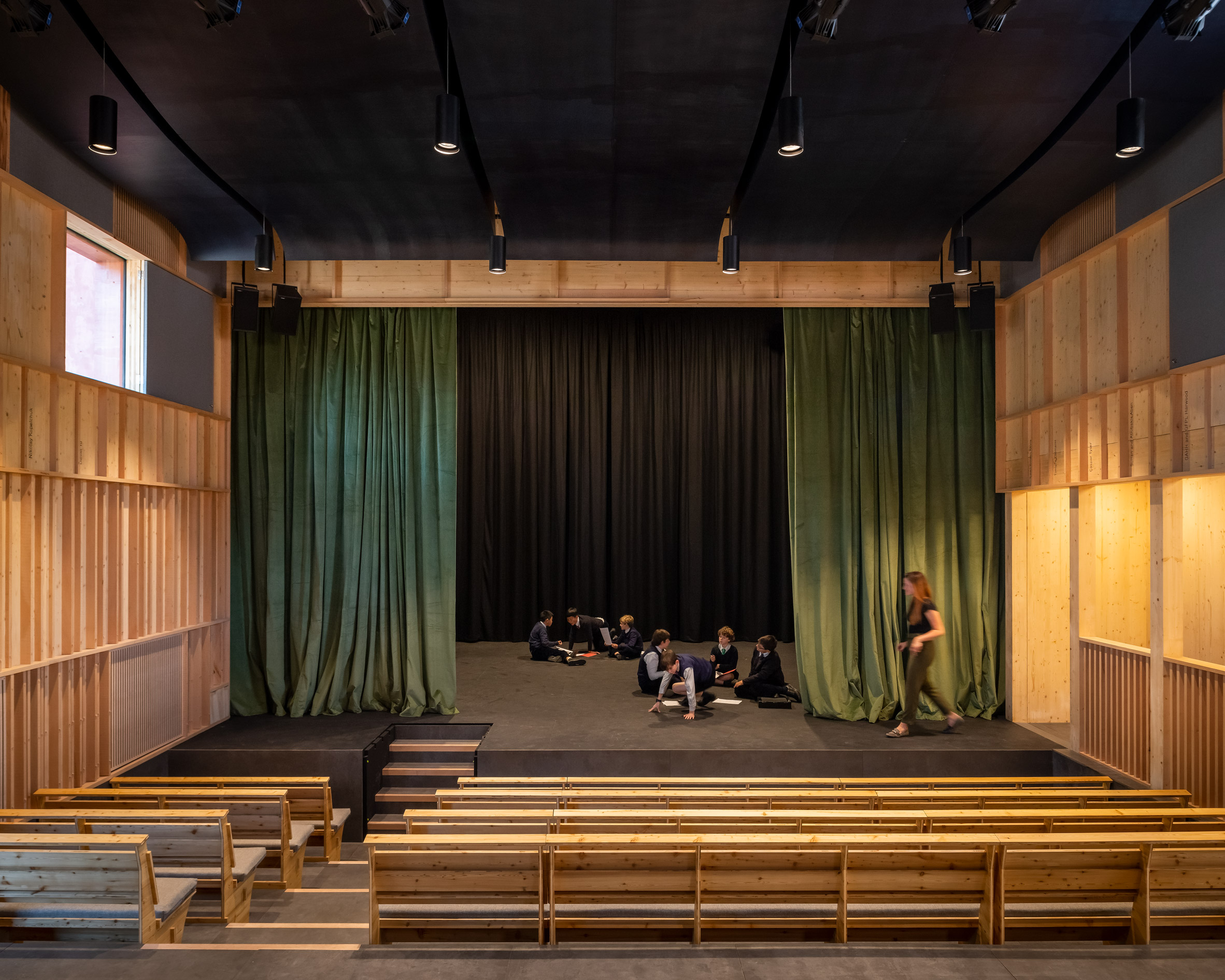 Theatre stage with green curtains by Jonathan Tuckey Design