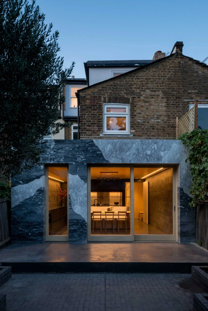 Marble-clad kitchen extension of Hansler Road house at night