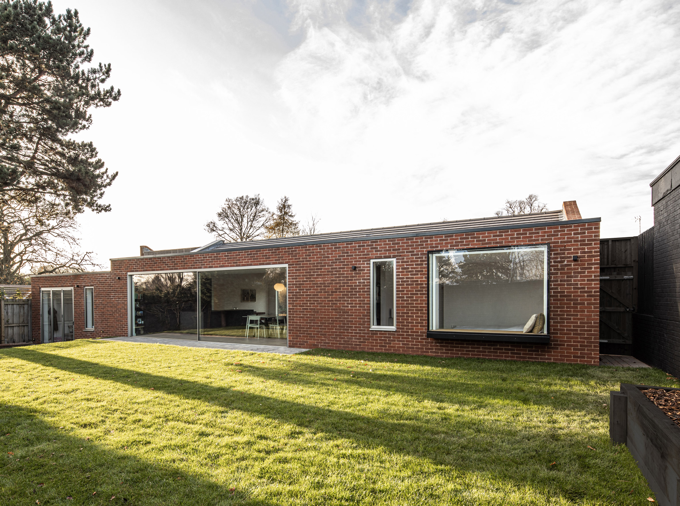 Rear elevation of Honey and Walnut House by Intervention Architecture