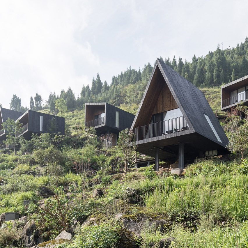 Different shaped cabins placed along a mountain terrain