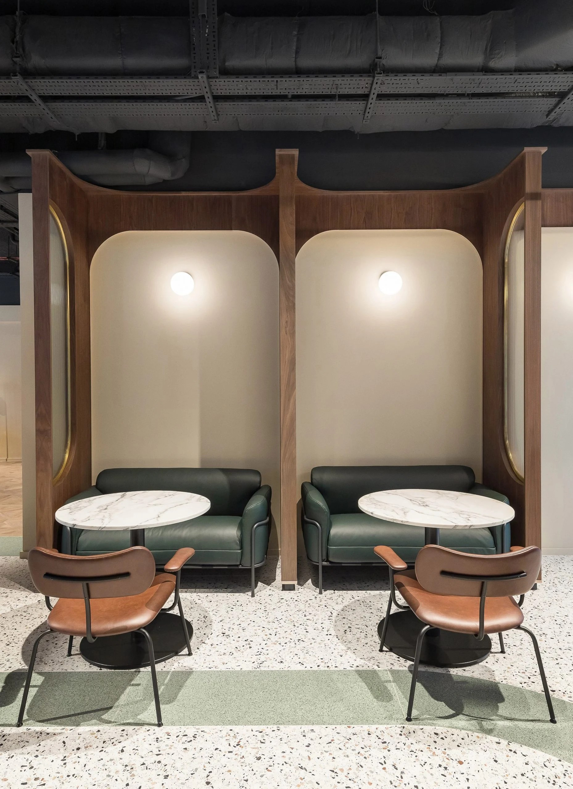 Seating booths at Chapter Old Street by Tigg + Coll Architects