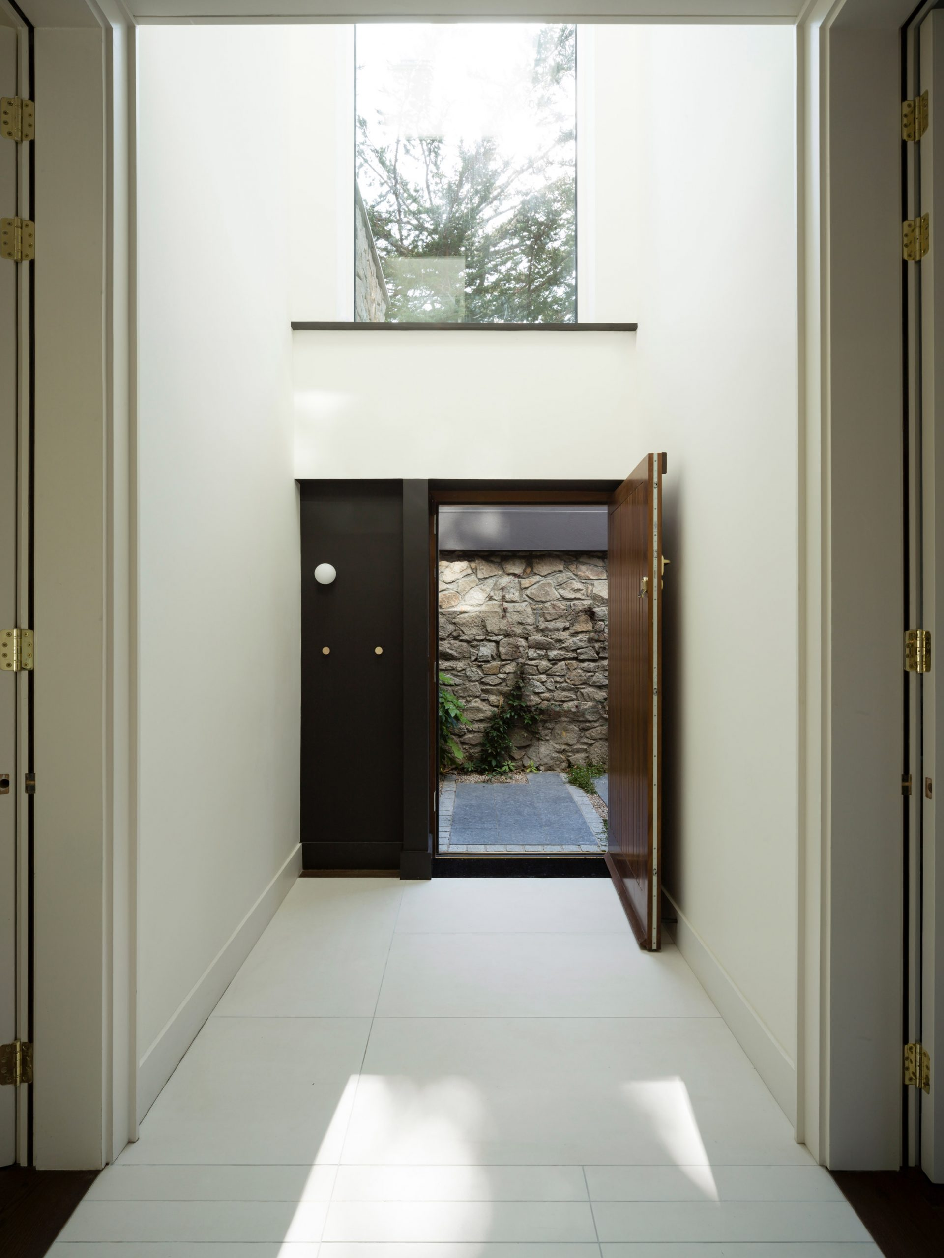Hallway of Corner House by Studio 304