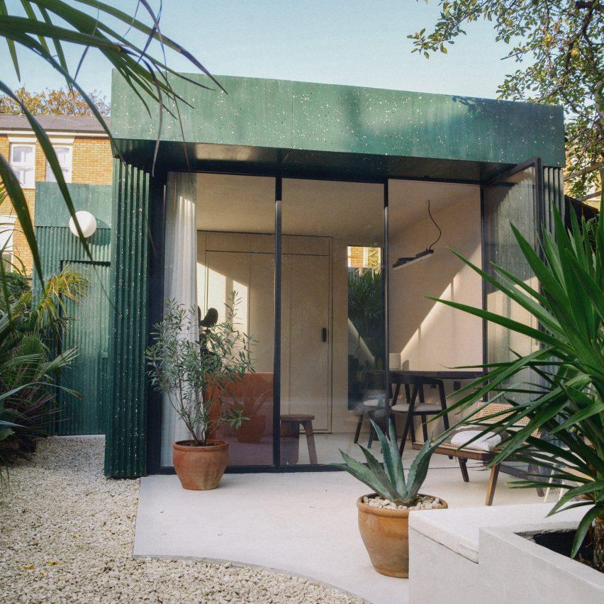 A garden studio clad in green terrazzo
