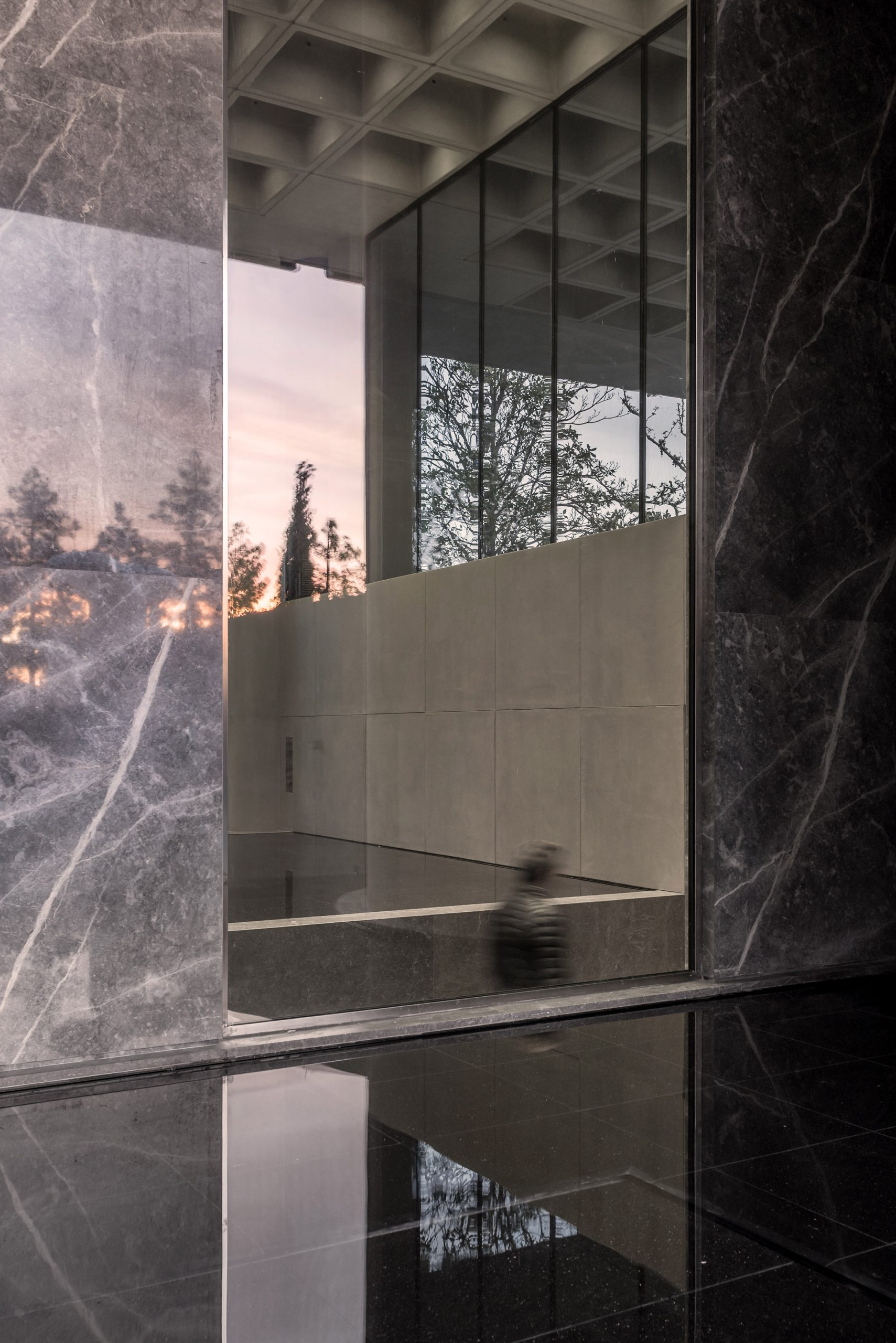 An office entrance lined with slabs of marble