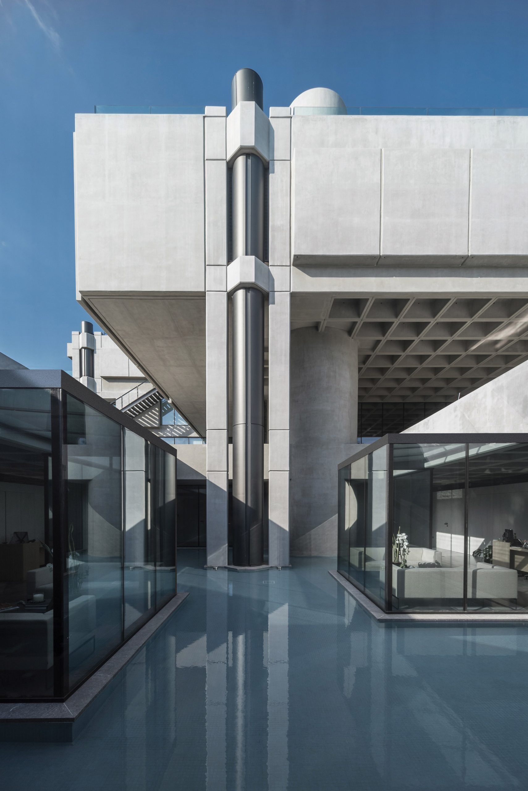 The concrete and glazed facades of a Greek office