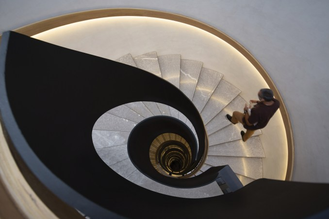 A spiral staircase with marble steps