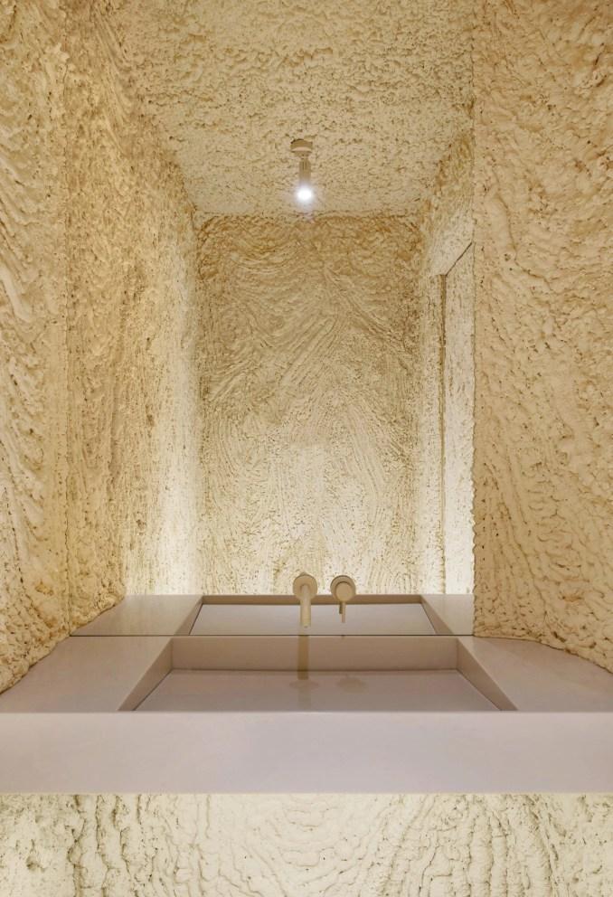 Foam-covered walls of cafe bathroom