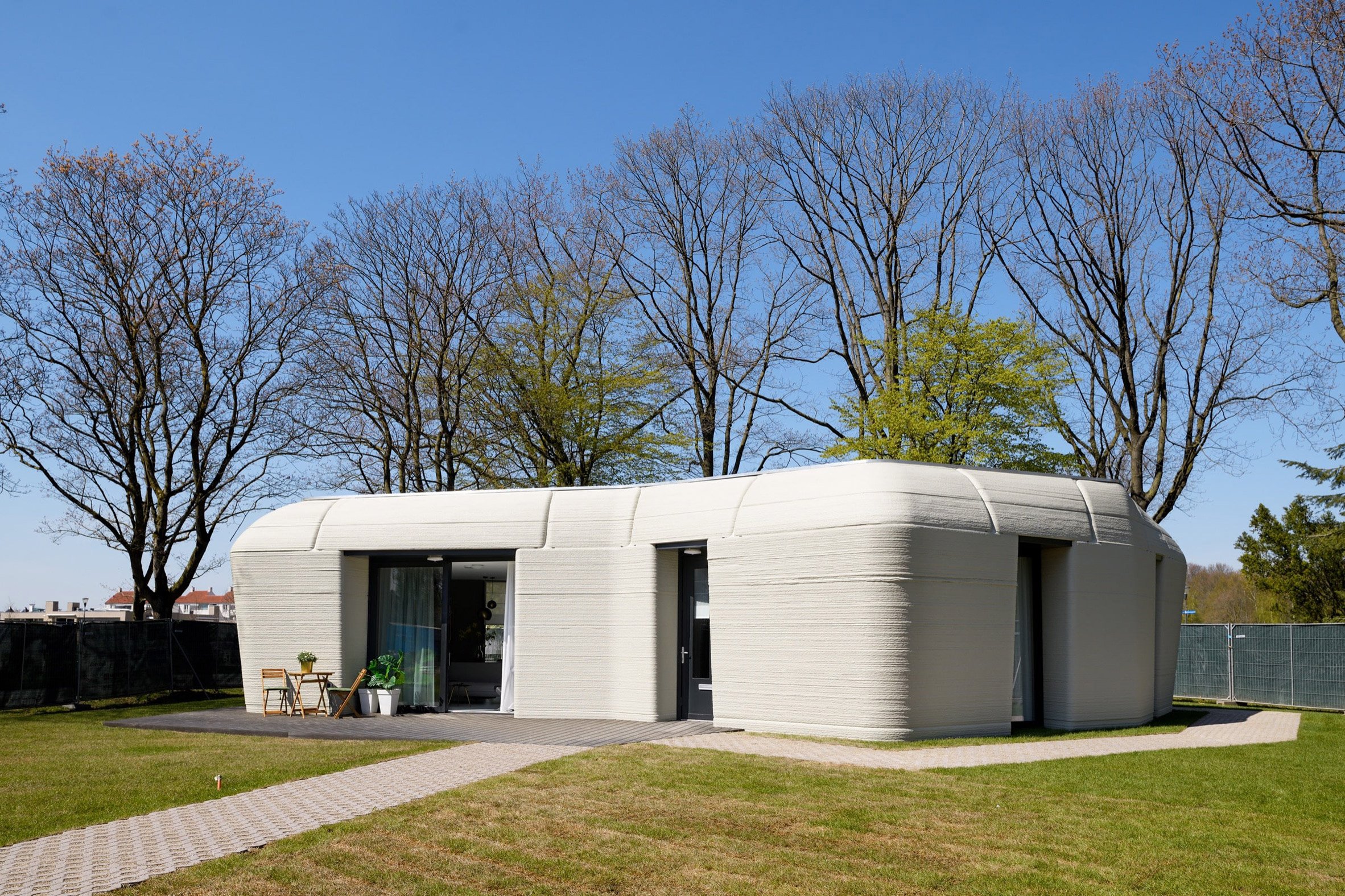 The shape of the 3D-printed home was informed by a boulder