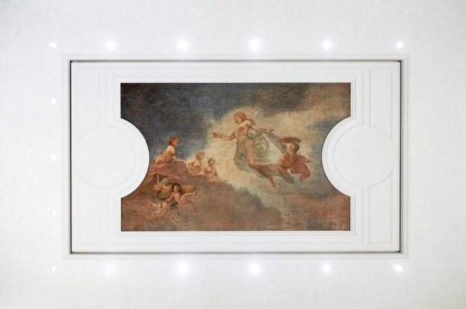 Lighting surrounds an original painting