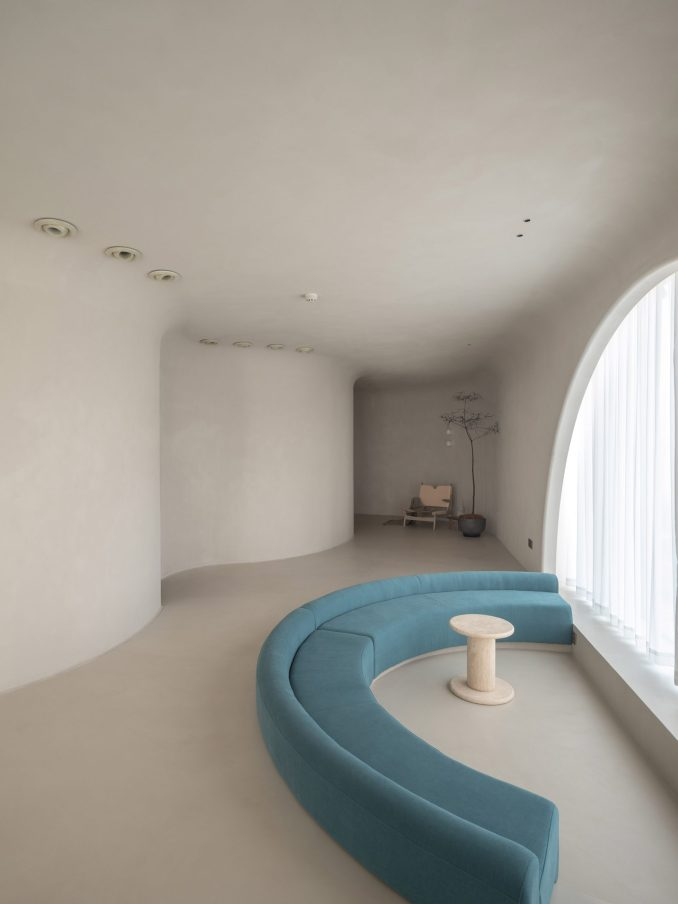 A blue sofa is located at the waiting area of Soul Realm Spa