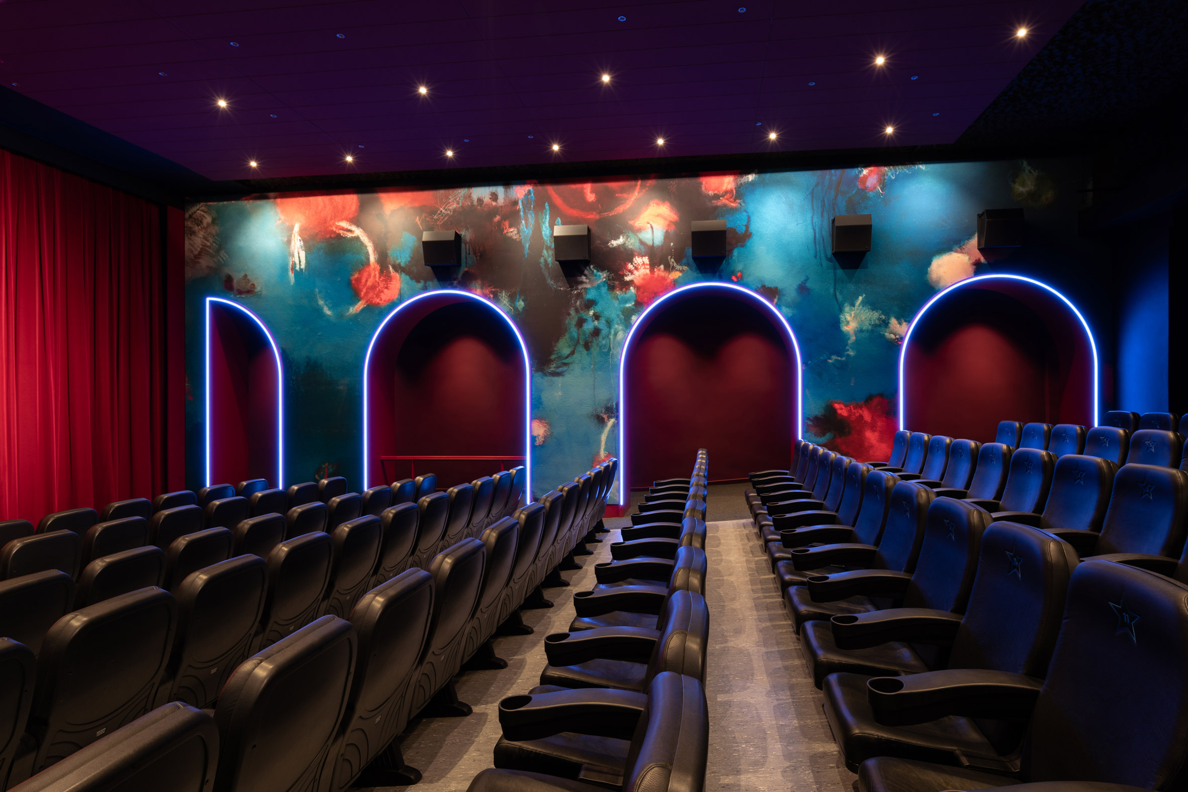 Cinema auditorium with neon decorations