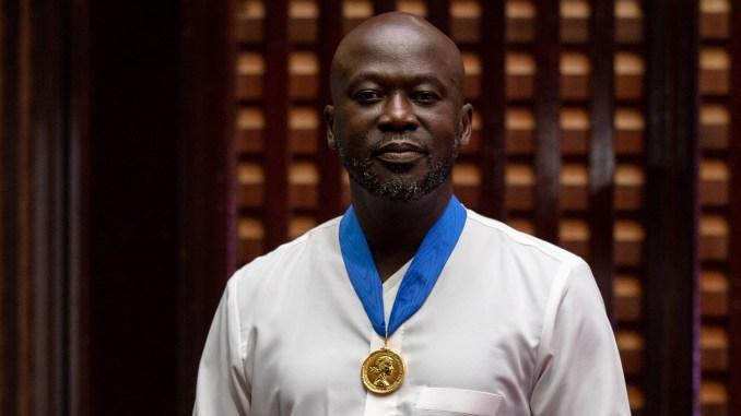 Adjaye wearing RIBA Royal Gold Medal