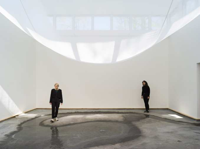 A white sheet is hung across a room at the Danish Pavilion