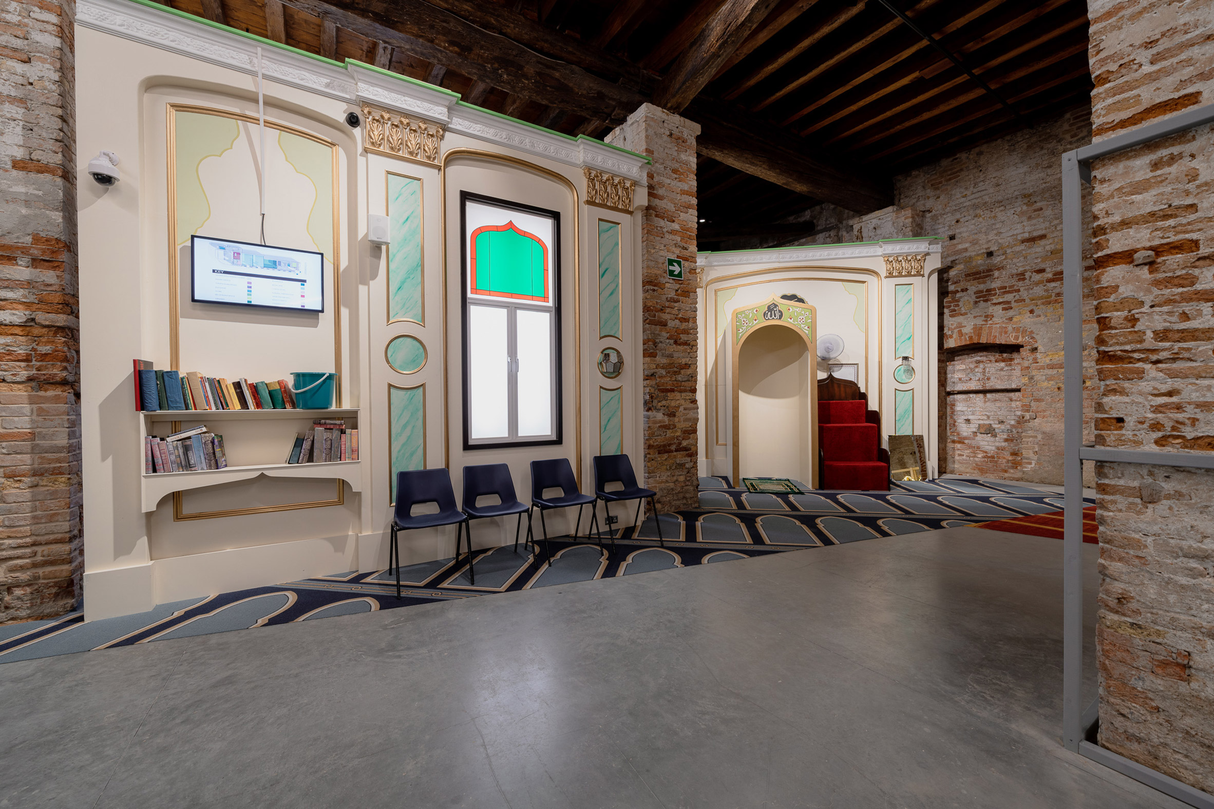 Books and chairs line the walls of the installation