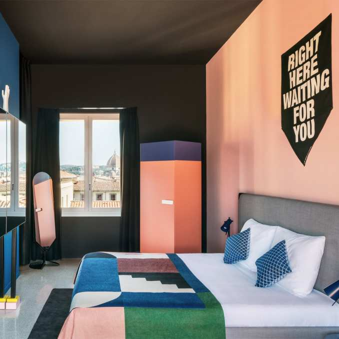 A colourful bedroom in The Student Hotel Florence Lavagnini