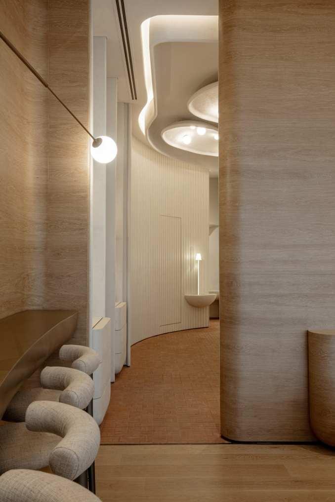 Counter seating with oak veneer walls in Sequel restaurant interior