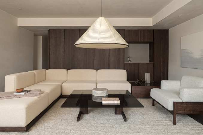 Living room with white armless sofa
