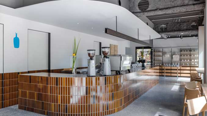 Curving counter with brown tiles in Blue Bottle Coffee Shibuya