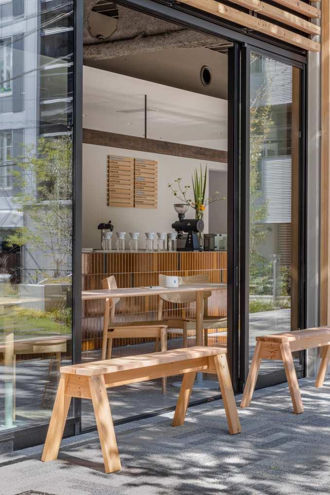 Wooden benches outside coffee shop by Keiji Ashizawa Design