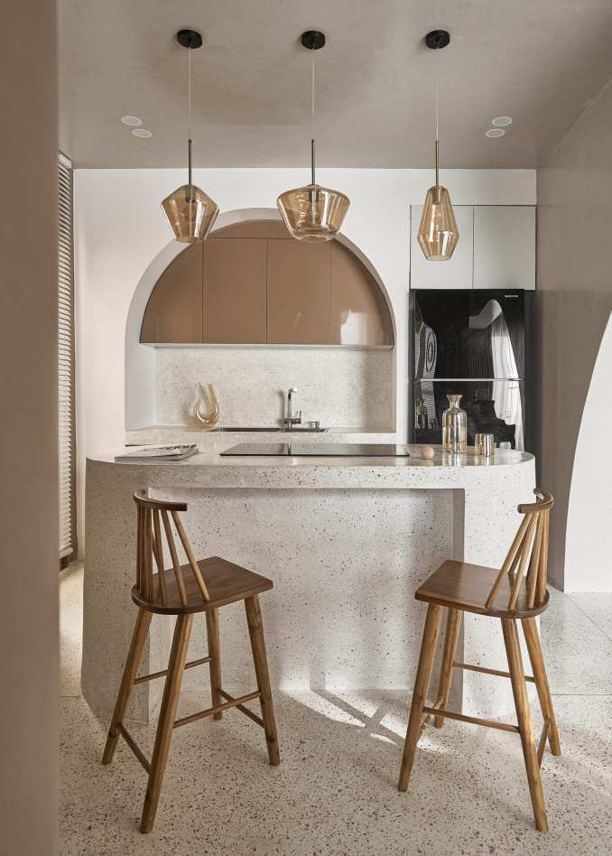 A kitchen island doubles as a breakfast bar at Brown Box