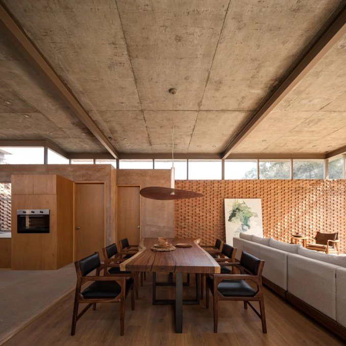 Wooden dining table of Casa UC in Mexico