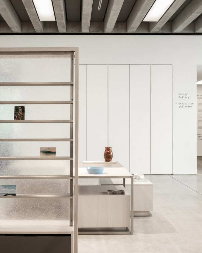 Magazine display and low tables with vases in Turner Contemporary Store