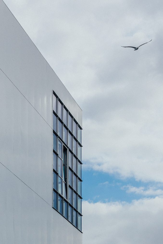 Large windows on aluminium-clad facade