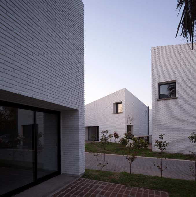 Brick homes with angled roofs
