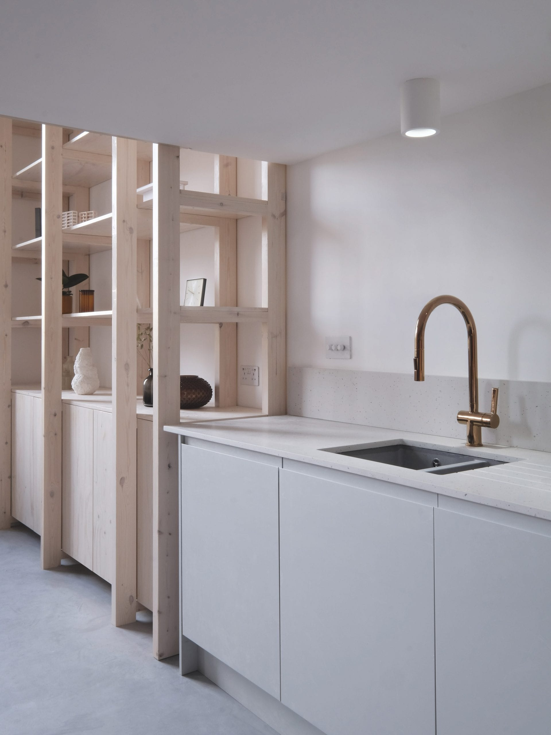 EBBA Architects used clean lines in this one-wall kitchen