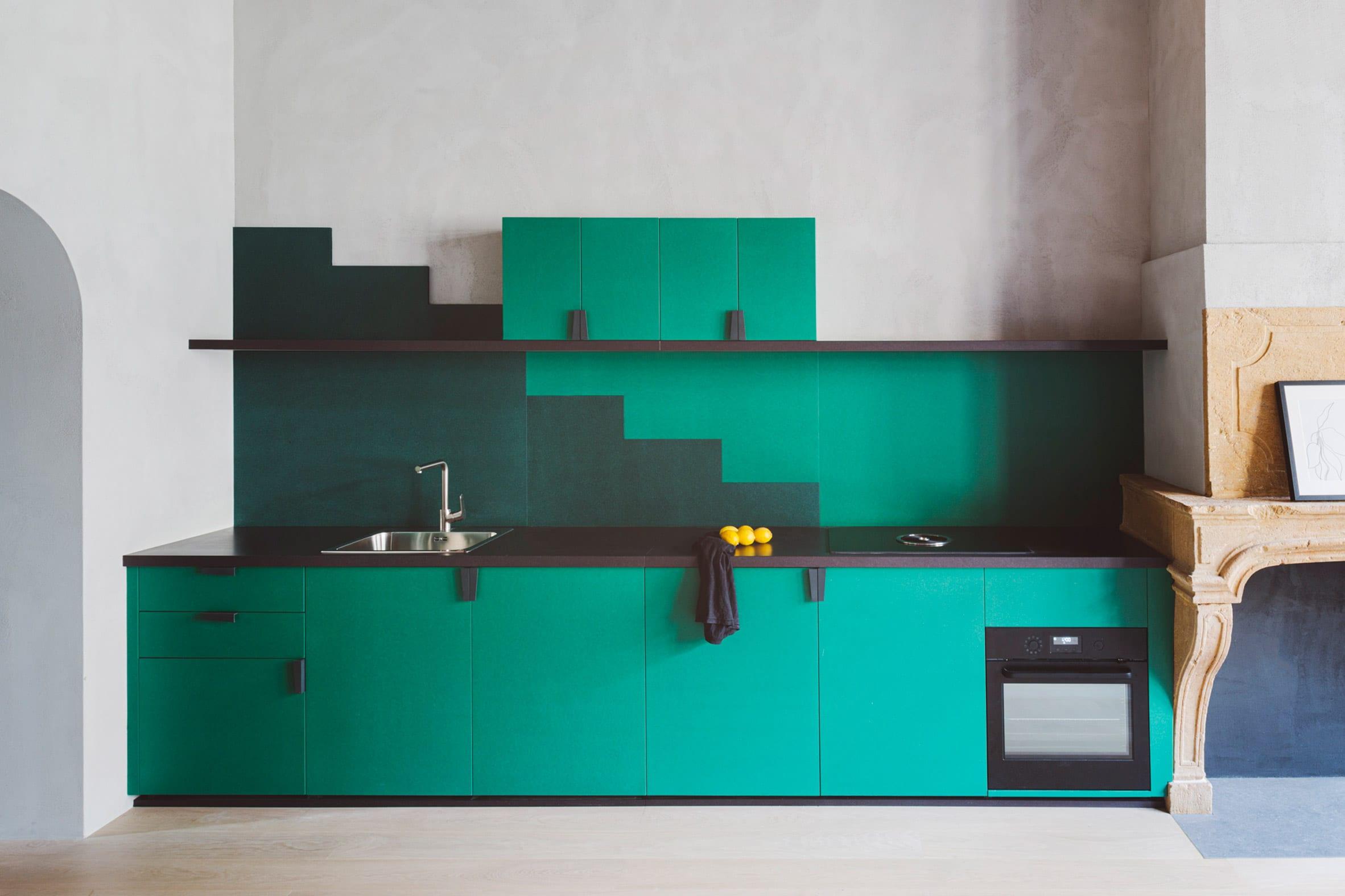 Green geometric one-wall kitchen by Studio Razavi