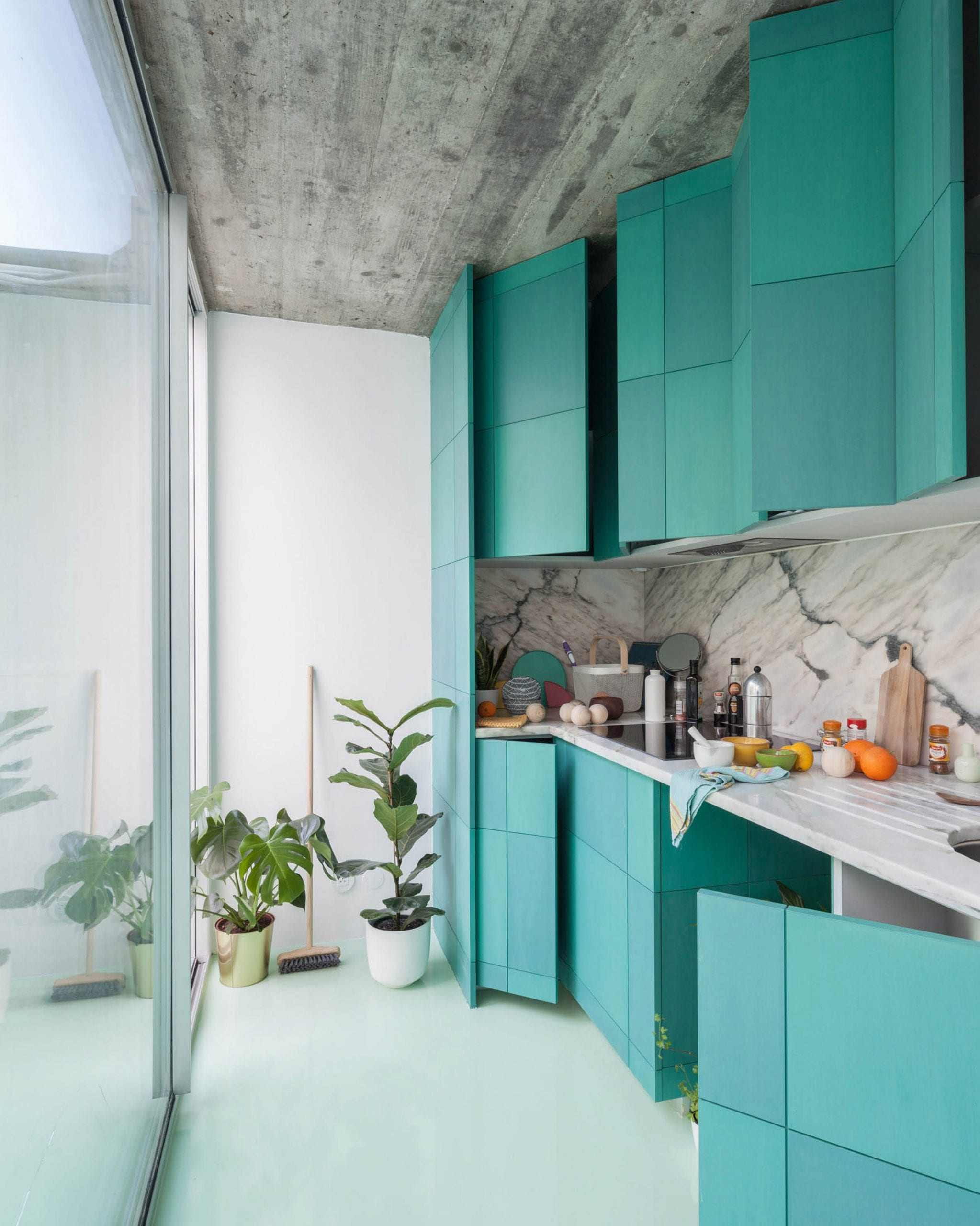 Fala Atelier oriented the one-wall kitchen toward a courtyard