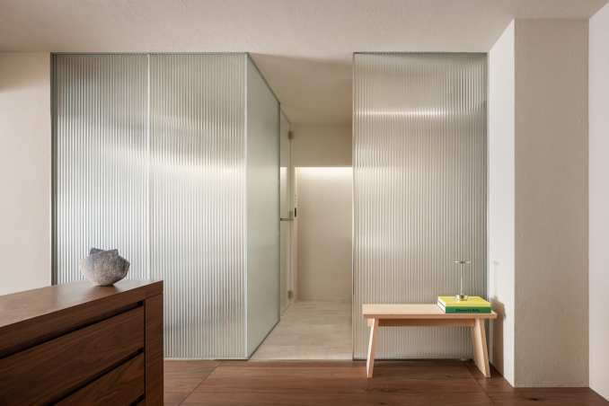 Reeded glass partitions and wood cupboard in The Life concept apartment