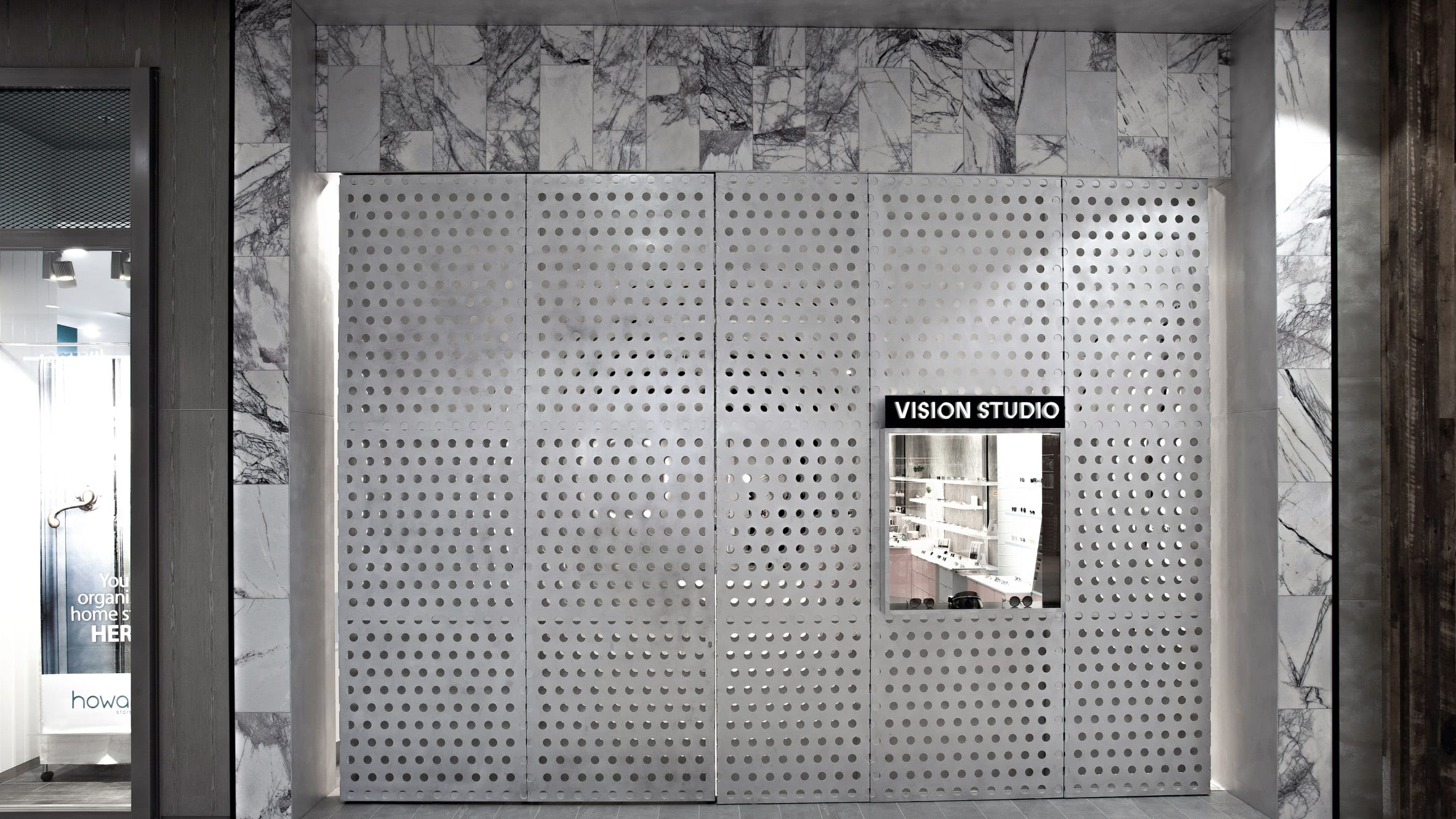 Perforated aluminium facade of retail interior by Studio Edwards