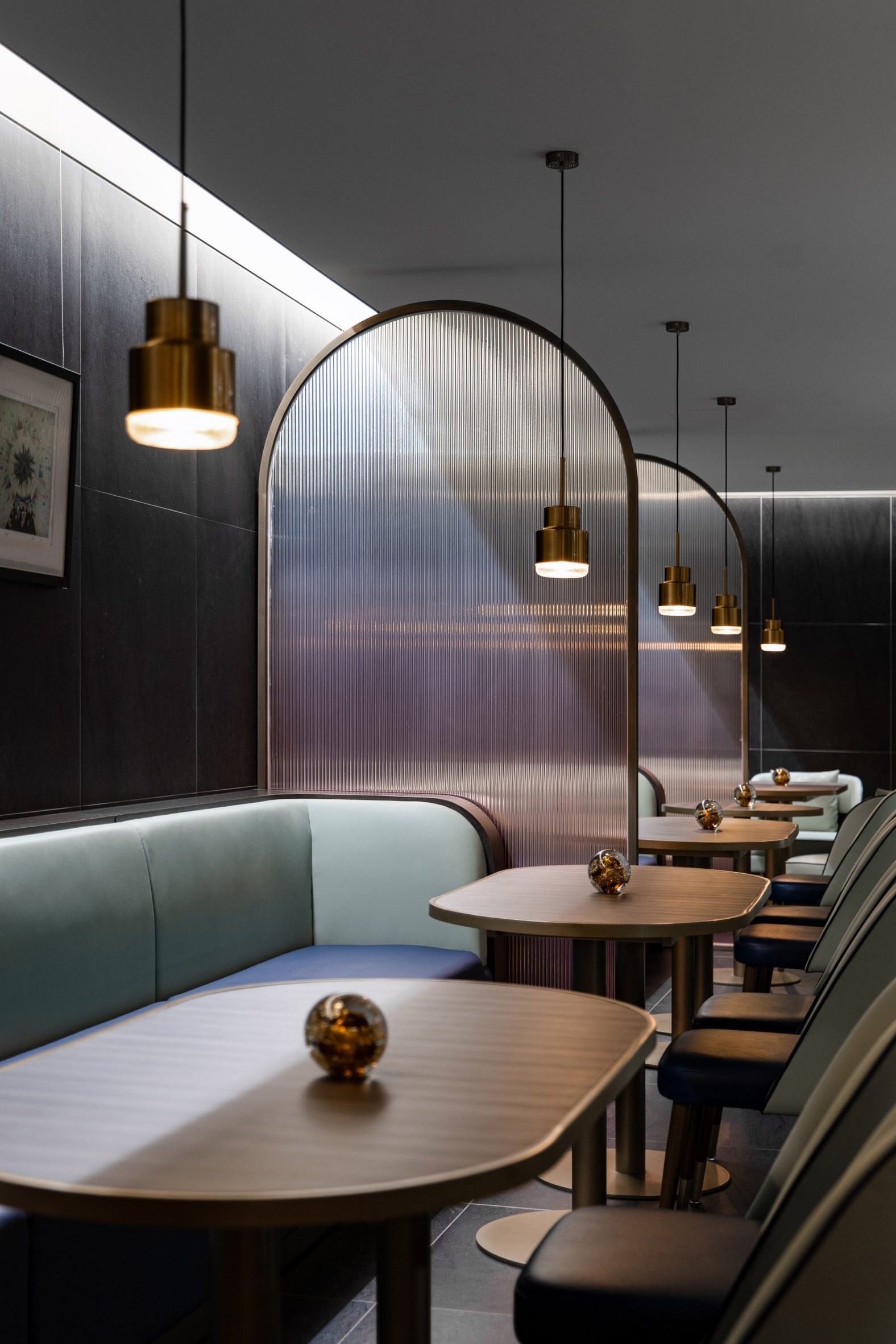 Ombre glass dividers in dining hall interior by SHH