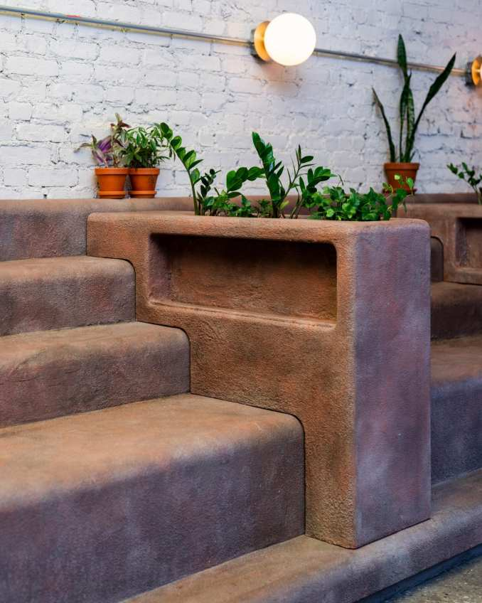 Planters sit between the stooped seating in Daughter