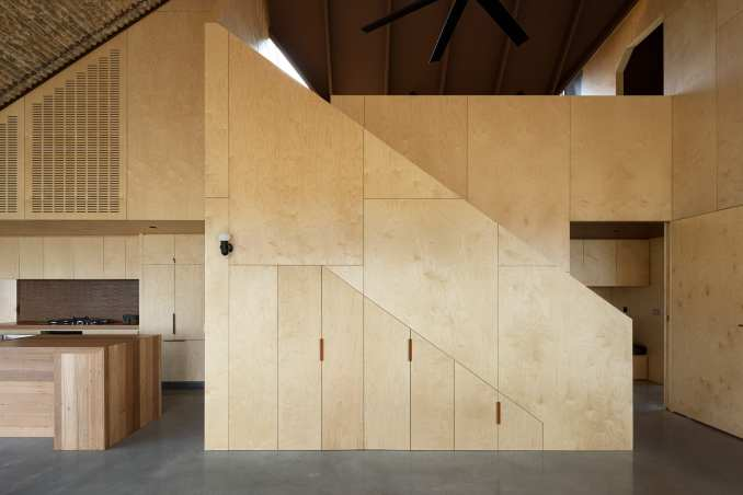 A mezzanine looks over the living space at Coopworth house