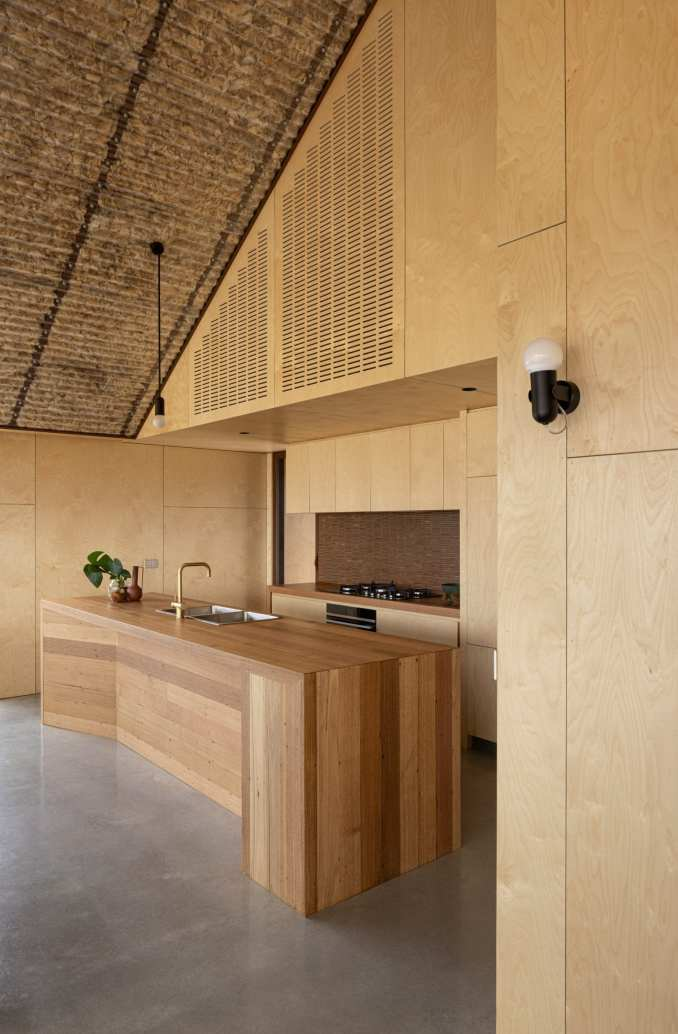 Plywood covers the walls of the kitchen at Coopworth house